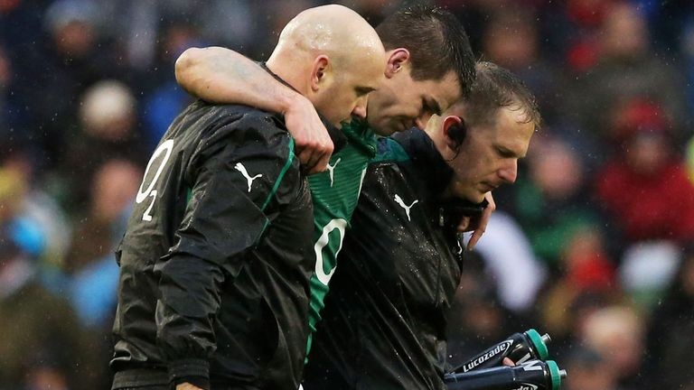 Jonathan Sexton limps off against England during February