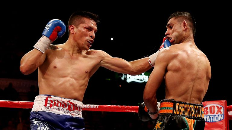 Amir Khan takes a big left hand from Julio Diaz on the way to a points win