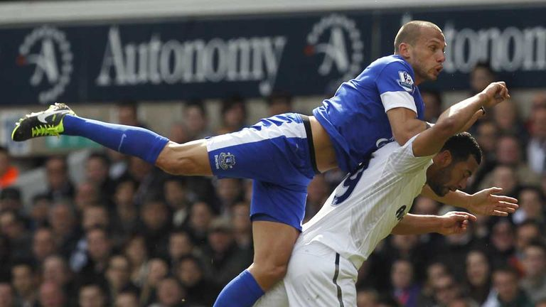John Heitinga: Everton defender in action against Tottenham