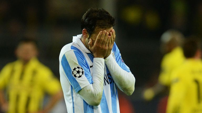 Misery for Malaga after their late defeat by Borussia Dortmund