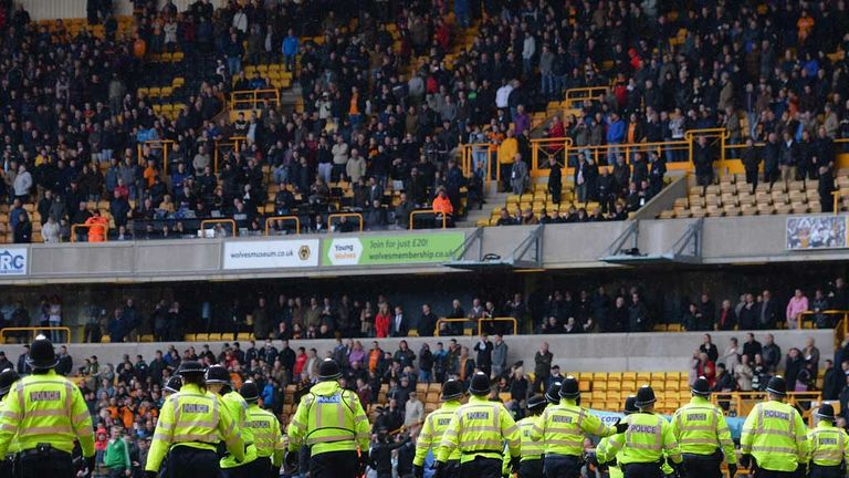 Police line the pitch after Wolves lose to Burnley at Molineux