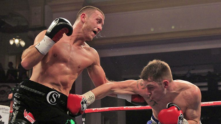 Scotty Cardle (L) delivered on his earlier promise against Maxi Hughes (Pic Lawrence Lustig)