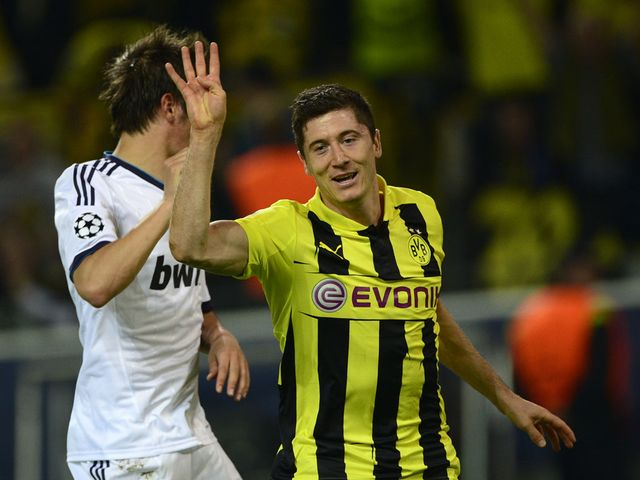 Robert Lewandowski celebrates his fourth goal for Dortmund