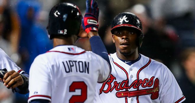 BJ and Justin Upton celebrate as the Braves win
