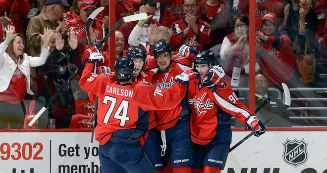 Alex Ovechkin is mobbed after his goal for the Washington Capitals