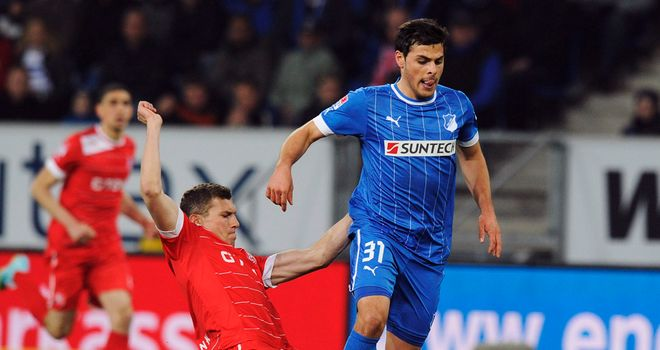 Oliver Fink tries to stop Kevin Volland.
