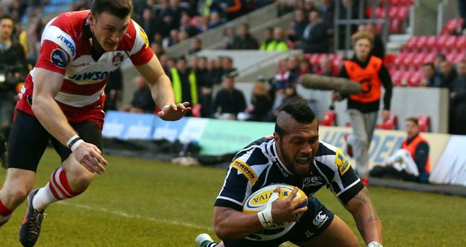 Johnny Leota dives over for the opening try