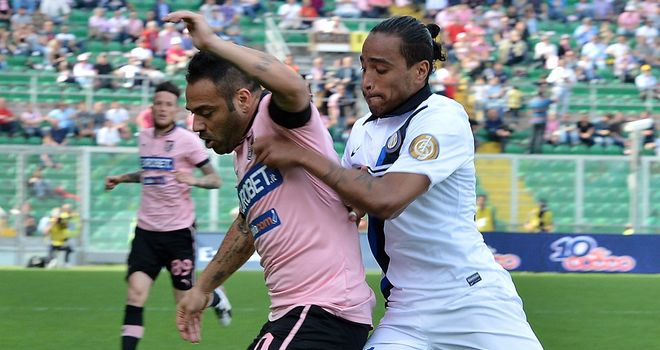 Fabrizio Miccoli and Alvaro Pereira battle for the ball