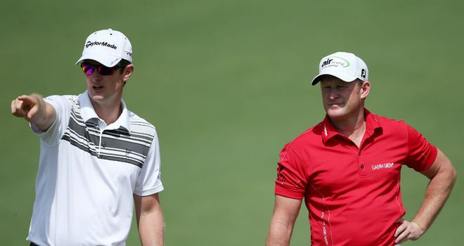 Jamie Donaldson (R) picks up some tips during Justin Rose during a practice round at Augusta