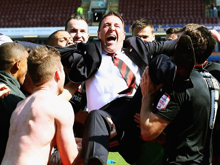 Malky Mackay leads the celebrations for Cardiff