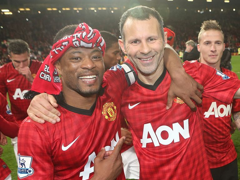 Giggs: Celebrates winning his 13th title with Evra