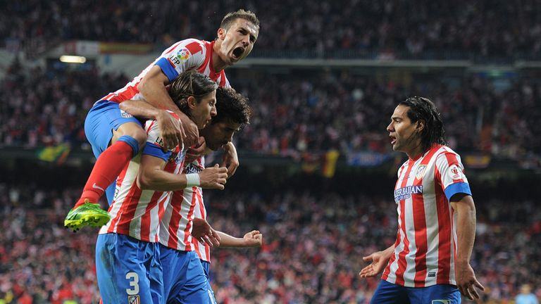 Gabi (l), Felipe Luis (number three) and Radamel Falcao (r): Celebrate Atletico Madrid's first goal against Real Madrid