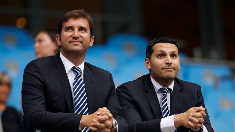 Manchester City chairman Khaldoon Al Mubarak (r), talks to chief executive Ferran Soriano
