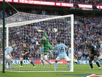 Ben Watson heads home Wigan's late winner at Wembley
