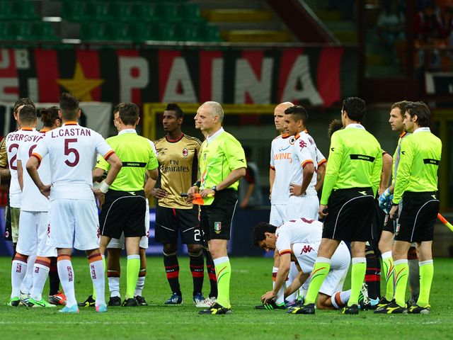 Play is briefly suspended at the San Siro