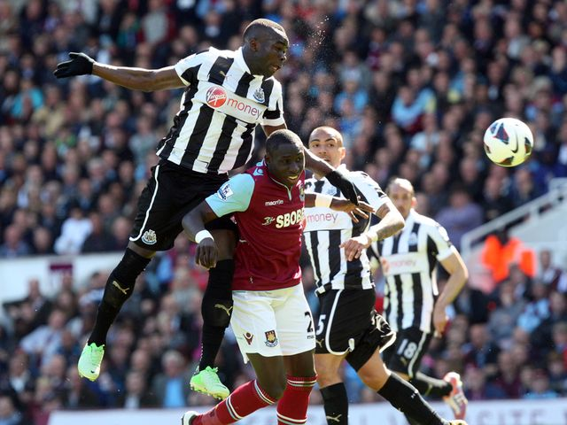 Cheick Tiote rises above Mohamed Diame.