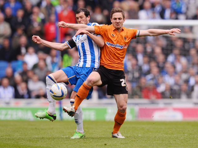 Gordon Greer battles with Kevin Doyle.