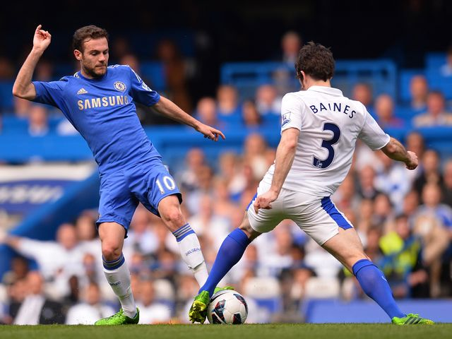 Leighton Baines and Juan Mata battle for the ball