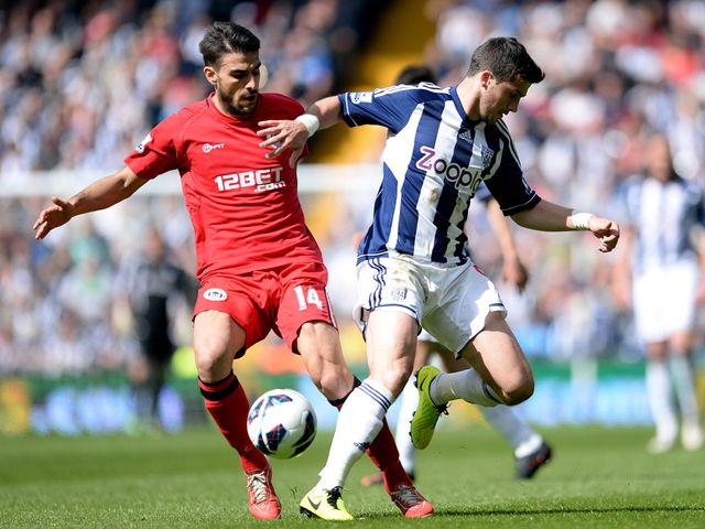 Jordi Gomez and Shane Long in action.