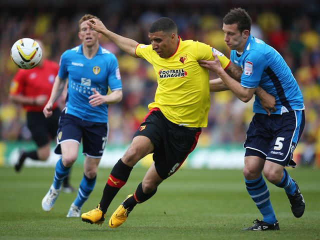 Troy Deeney  is challenged by Jason Pearce.