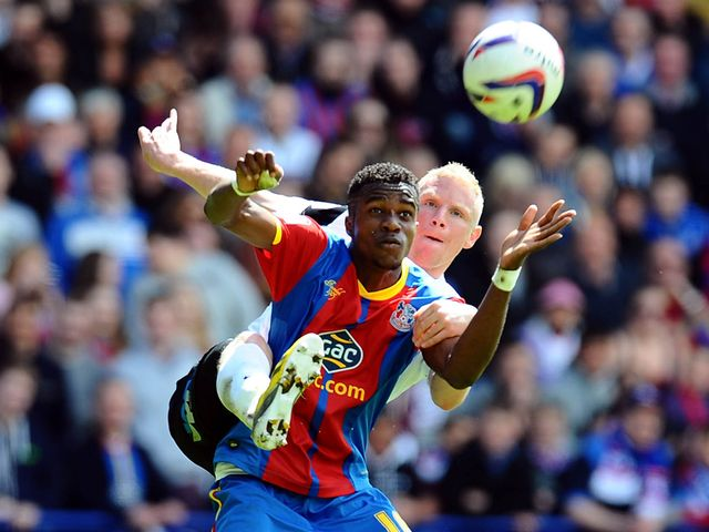 Wilfried Zaha and Craig Alcock tangle.