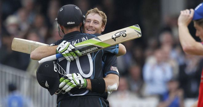 Guptill and James Franklin celebrate New Zealand's victory