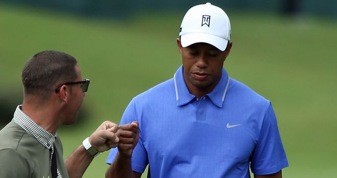 Tiger Woods (with coach Sean Foley in practice) has struggled at Sawgrass