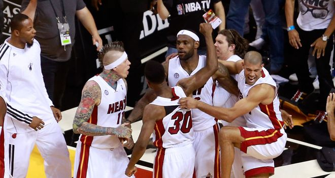 LeBron James (centre) celebrates with team-mates after the buzzer