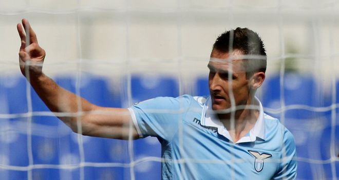 Miroslav Klose celebrates one of his five goals for Lazio