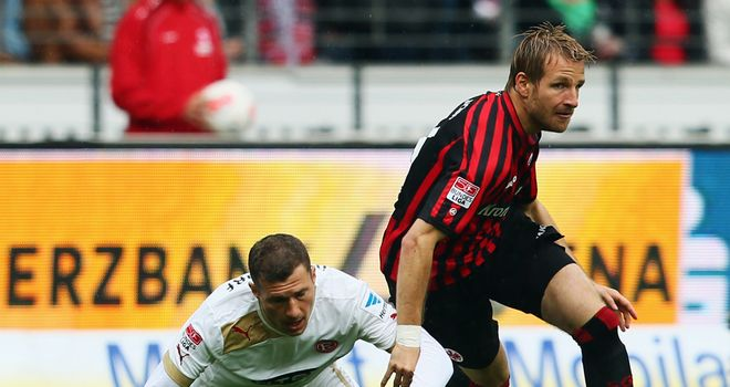 Stefan Aigner of Frankfurt is challenged by Oliver Fink