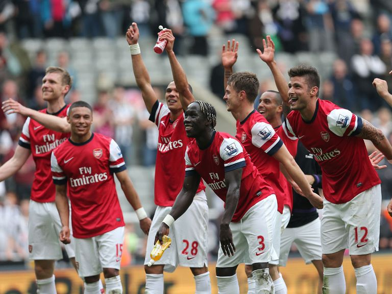 Arsenal celebrate the victory that secured Champions League qualification.