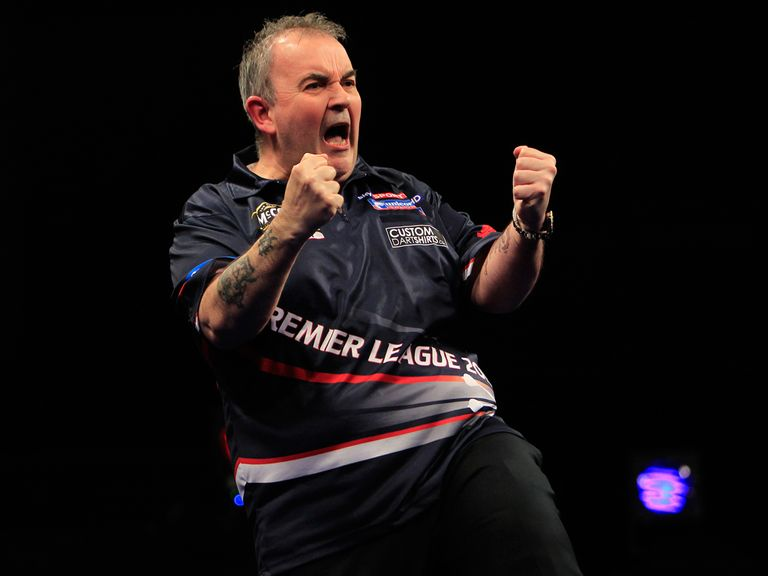 Phil Taylor: Safely into round two