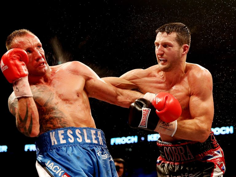 Kessler (l) and Froch during last year's rematch at the O2