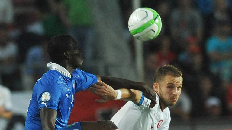Michal Kadlec (R) vies for the ball with Mario Balotteli