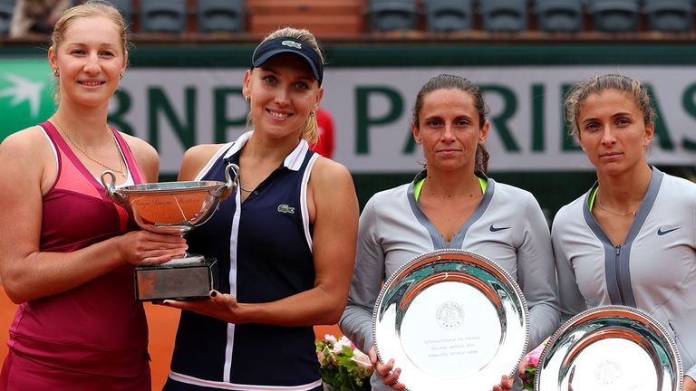 Ekaterina Makarova and Elena Vesnina are all smiles while the beaten Italians look a little more subdued