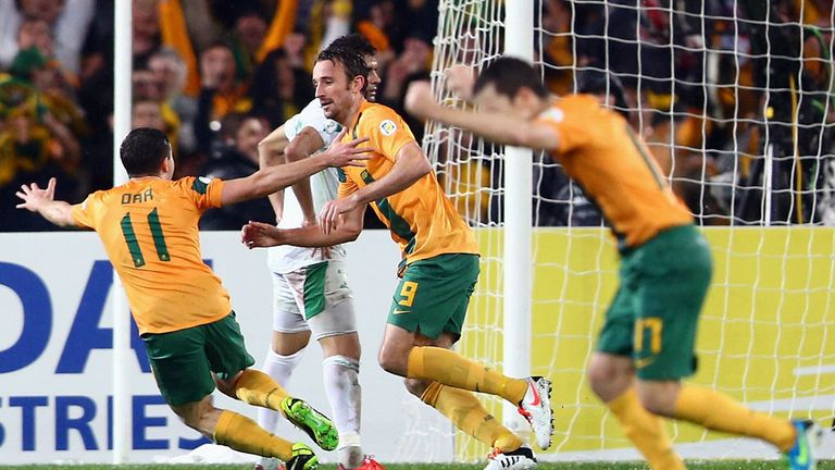Josh Kennedy and team-mates celebrate Australia's winner