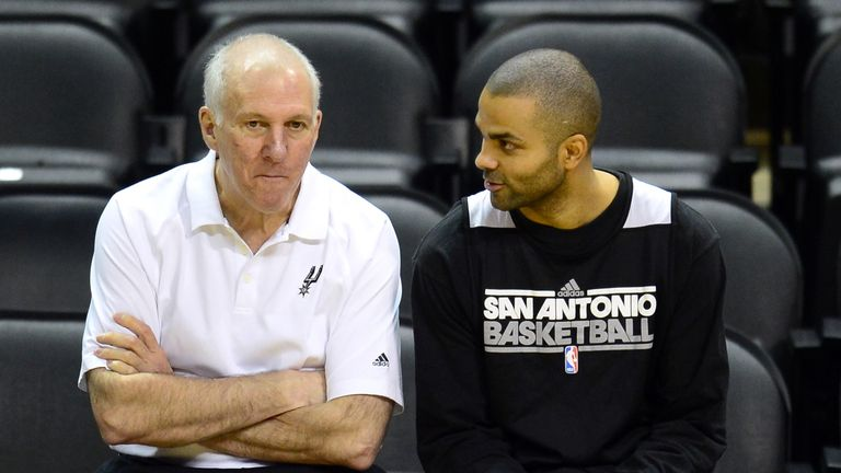 Gregg Popovic (left) with Tony Parker