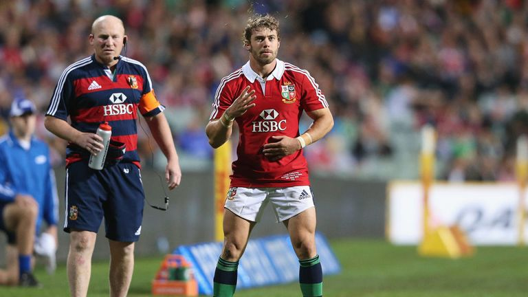 Lions coach Neil Jenkins watches Leigh Halfpenny line up a kick