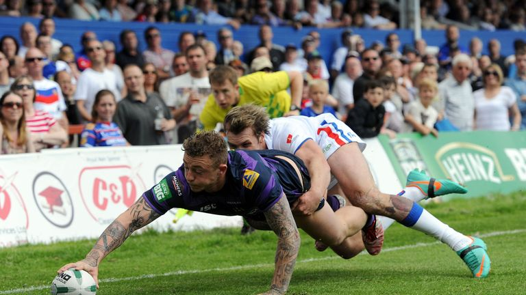 Josh Charnley touches down the first of his three tries in Wigan's win at Wakefield