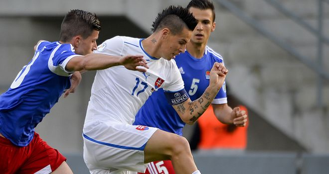 Marek Hamsik battles his way forward