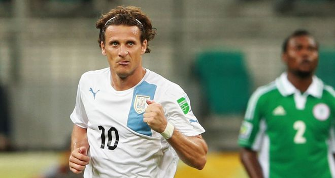 Diego Forlan: Celebrates his decisive goal