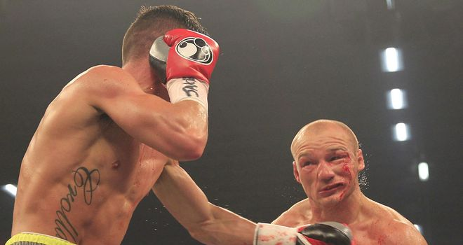 Gavin Rees (R) is caught by a left hook in his defeat to Anthony Crolla (Pic Lawrence Lustig)