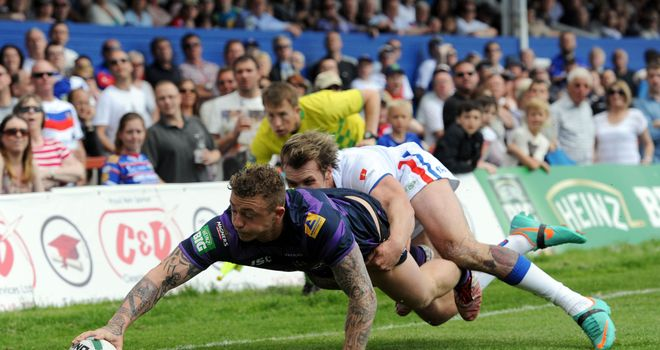 Lukas Walshaw (tackling Josh Charnley) has returned to Wakefield for treatment