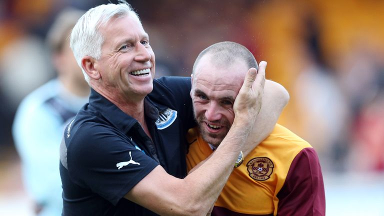 Newcastle boss Alan Pardew shares a joke with James McFadden after the final whistle