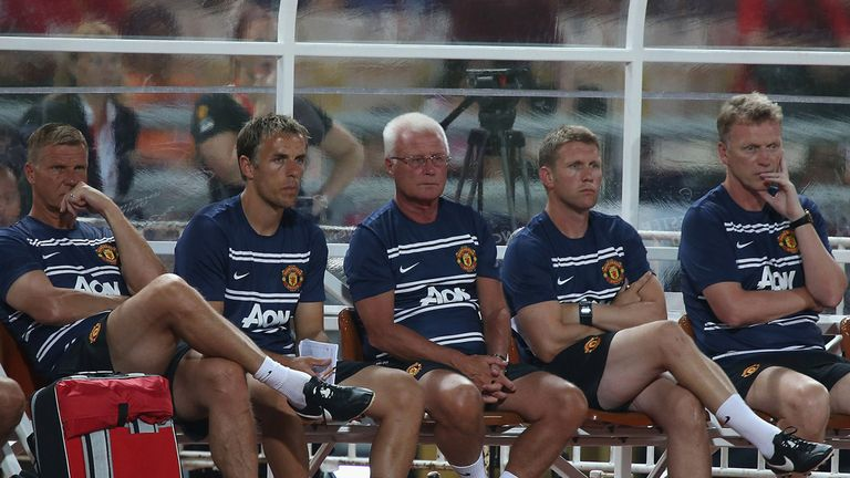 Phil Neville (left-centre): The coach has backed David Moyes (right) to succeed as Manchester United boss