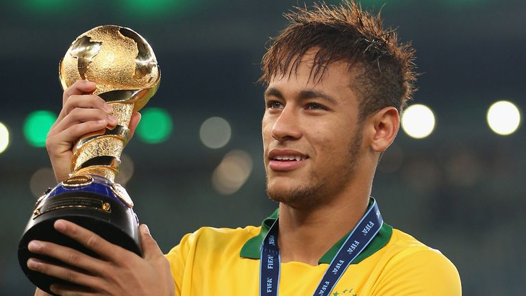 Neymar: Celebrates with the trophy after Brazil beat Spain 3-0