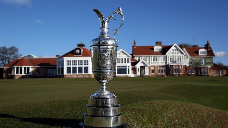 The Claret Jug trophy beside the 18th green in front of the clubhouse at Muirfield