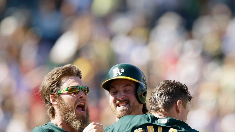 Oakland Athletics celebrate their victory over the Boston Red Sox on Sunday