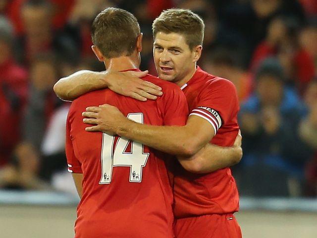 Steven Gerrard: Celebrates Liverpool's opener with Jordan Henderson