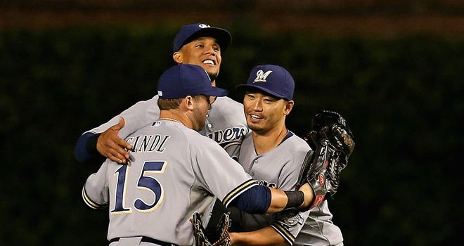 Milwaukee Brewers celebrate their 5-0 victory over the Chicago Cubs on Monday